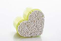 Heart-shaped container with cotton swabs Royalty Free Stock Photo