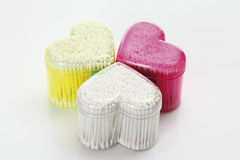 Heart-shaped containers with cotton swabs Royalty Free Stock Images