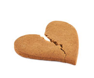 Heart shaped cookie broken Stock Photo