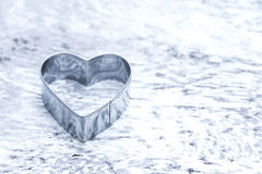 Heart shaped cookie cutter concept Royalty Free Stock Photography