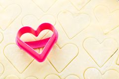 Heart shaped cookie cutter on raw dough Royalty Free Stock Images
