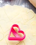 Heart shaped cookie cutter on raw dough Royalty Free Stock Photo