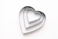 Heart shaped cookie cutter. On white background Stock Photos