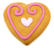Heart shaped cookie with a pink frosting decoratio Royalty Free Stock Image