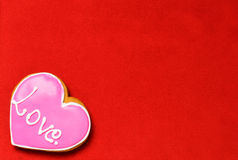 Heart Shaped cookie on red carpet texture Stock Photos