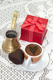 Heart shaped cookie with red gift box with bow and cup of coffee Royalty Free Stock Image