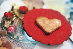 Heart shaped cookie on small red napkin Royalty Free Stock Photos