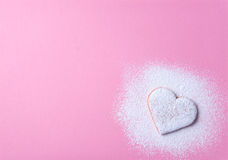 Heart shaped cookie 1. Heart shaped cookie with sugar icing on a pink paper background stock image