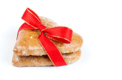 Heart shaped cookie tied with red ribbon Royalty Free Stock Image