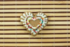Heart-shaped cookie for Valentines Day. Greeting card royalty free stock image