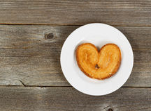 Heart shaped cookie on white plate Stock Image