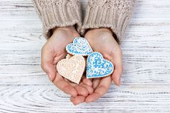 Heart-shaped cookie in woman's hands holiday cookies royalty free stock image