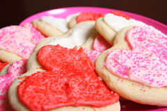 Heart-shaped cookies. Pink, Red and White heart-shaped cookies royalty free stock images