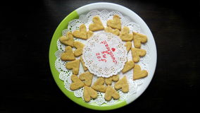 Heart shaped cookies appears on a plate stop motion animation stock video footage