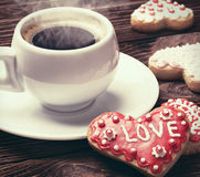 Heart shaped cookies baked on valentines day and a cup of coffee Royalty Free Stock Images