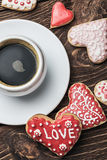 Heart shaped cookies baked on valentines day and a cup of coffee Stock Images
