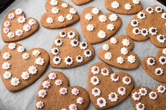 Heart shaped cookies on baking paper Royalty Free Stock Photos