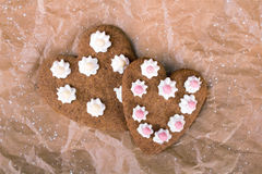 Heart shaped cookies on baking paper Stock Photography
