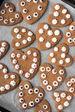 Heart shaped cookies on baking paper background Stock Photos