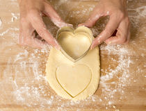 Heart Shaped Cookies Being Cut Royalty Free Stock Image