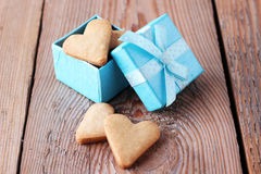 Heart shaped cookies in a blue gift box on a wooden background Stock Photography