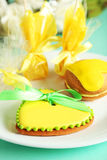 Heart shaped cookies with candies on green background Royalty Free Stock Photo