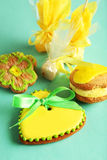 Heart shaped cookies with candies on the green background Stock Images