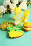 Heart shaped cookies with candies on the green background Royalty Free Stock Photography