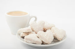 Heart shaped cookies  and cappuccino separate on white Stock Photos
