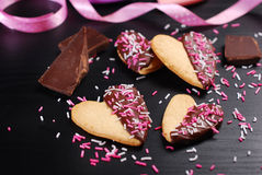 Heart shaped cookies with chocolate and sprinkles Stock Photos