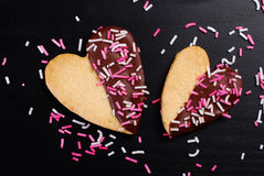 Heart shaped cookies with chocolate and sprinkles Royalty Free Stock Images