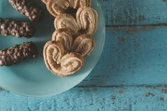 Heart shaped cookies and chocolates on a blue wooden surface. With a place for text, toned Royalty Free Stock Photography