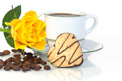Heart shaped cookies beside a coffee cup Stock Image