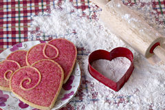 Heart shaped cookies and cutter Stock Images