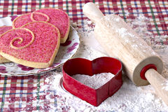 Heart shaped cookies, cutter and wooden rolling pin Royalty Free Stock Photo