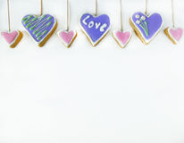 Heart-shaped cookies decorated with multicoloured icing Stock Photography
