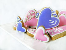 Heart-shaped cookies decorated for Valentine`s day Stock Images