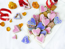 Heart-shaped cookies decorated for Valentine`s day Stock Photos