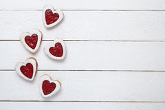 Heart shaped cookies with jam for Valentines day on white wooden background Royalty Free Stock Photos