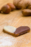 Heart-shaped cookies and nuts Stock Images
