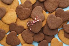 Heart shaped cookies pattern for Valentines day. Top view. Heart shaped cookies pattern for Valentines day. Cookie decorated as a gift. Top view stock photos