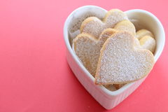 Heart shaped cookies. Powdered heart shaped cookies in a heart shaped cocotte Stock Photos