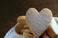 Heart shaped cookies. Powdered Heart shaped cookies on a glass plate Stock Photos