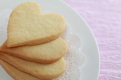 Heart shaped cookies. On race paper Royalty Free Stock Photo
