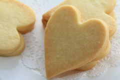 Heart shaped cookies. On race paper Royalty Free Stock Image