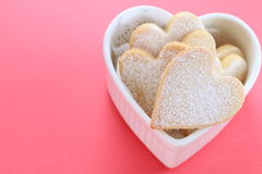 Heart shaped cookies. With red background Stock Photography