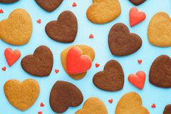 Heart shaped cookies and red candy background. Valentines Day. Top view royalty free stock images