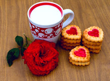 Heart-shaped cookies, rose and a cup of milk. Biscuits in a box, nectarines and a bouquet of roses Royalty Free Stock Images