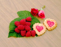 Heart-shaped cookies,  rose and a cup of milk. Biscuits in a box, nectarines and a bouquet of roses Stock Photography
