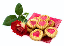 Heart-shaped cookies, rose. Heart-shaped cookies and red rose Royalty Free Stock Photos